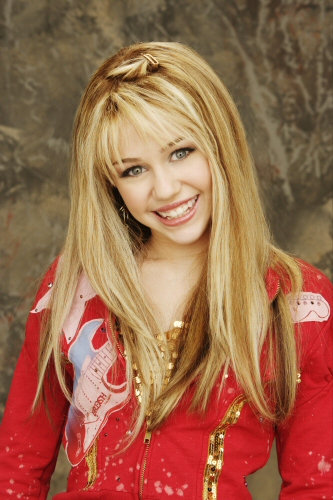 Miley Cyrus as Hannah Montana smiling to the camera.